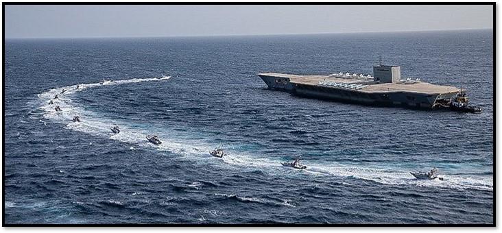 Speedboats approach fake carrier