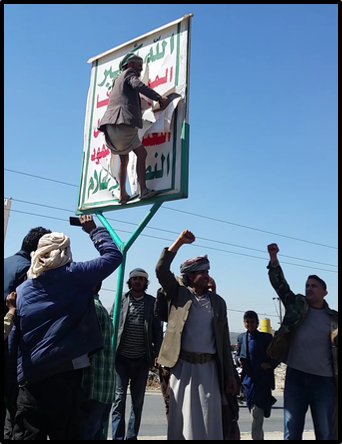 Protester rips down Houthi flag in Sanaa