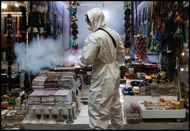 A worker cleans a store at Tajrish Bazaar in Tehran