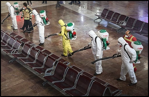 Workers sanitize Tehran's main bus station
