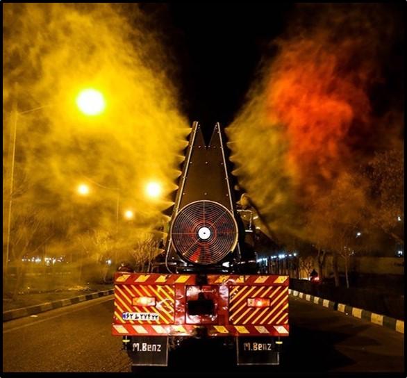 A firetruck disinfects a street in Tehran