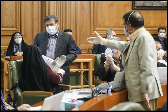 Masked lawmakers at a Tehran City Council meeting