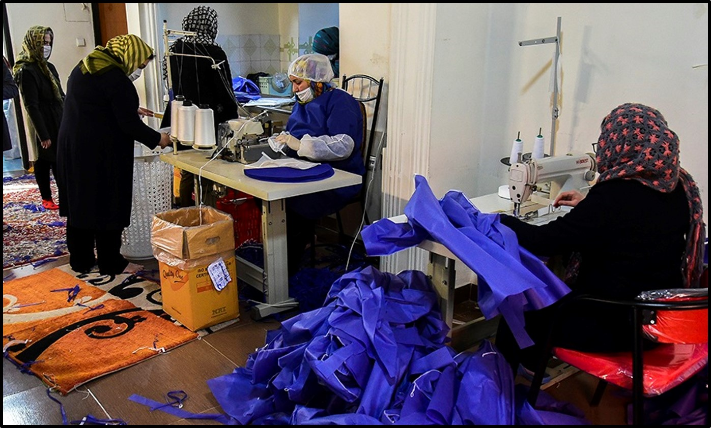 Women make hospital gowns at a factory in Qaemshahr