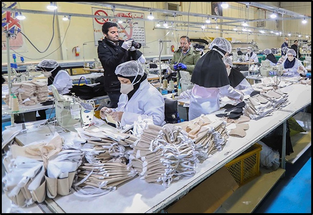 Workers at a mask production factory