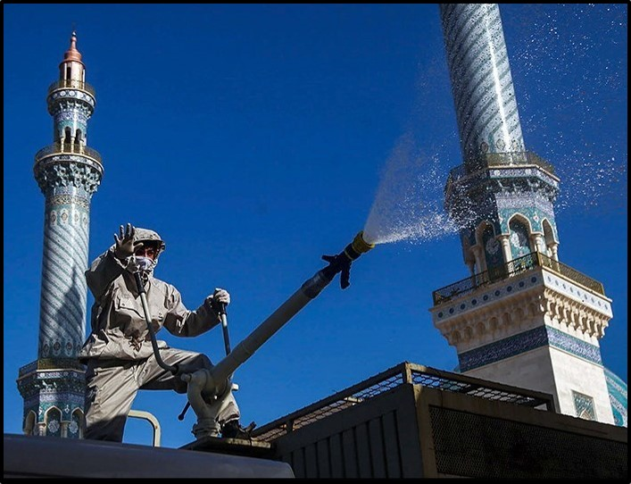 A worker cleans a mosque in Qom