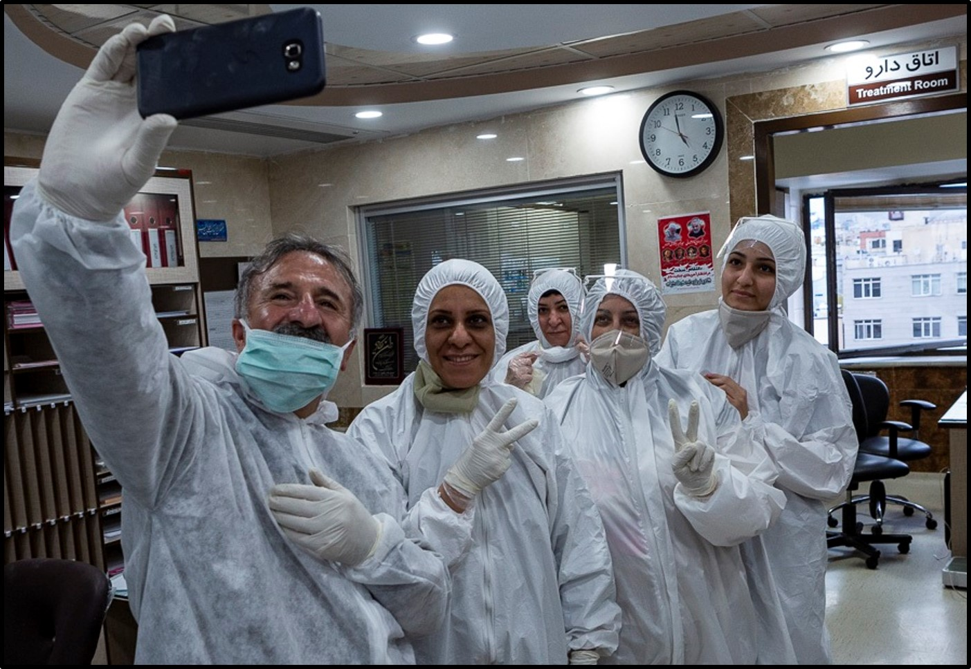 Medical workers took a selfie at a Tehran hospital
