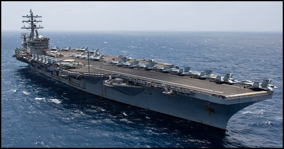 A U.S. aircraft carrier transits the Arabian Sea
